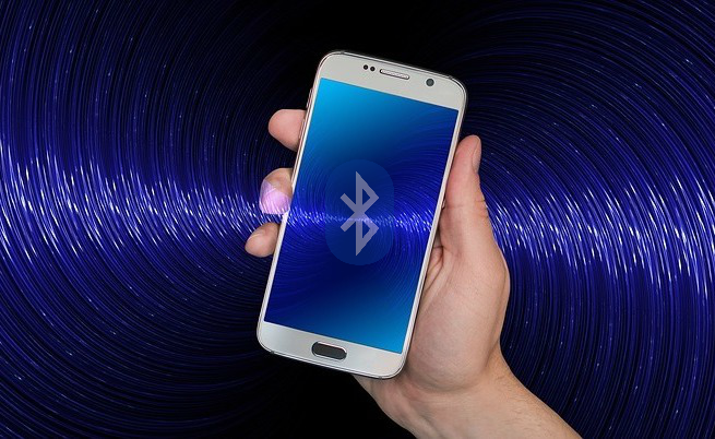 Illustrative image of a smartphone receiving Bluetooth waves.