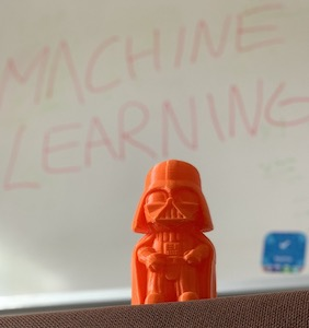 "An image of Darth Vader with a whiteboard behind that says ""Machine Learning"""